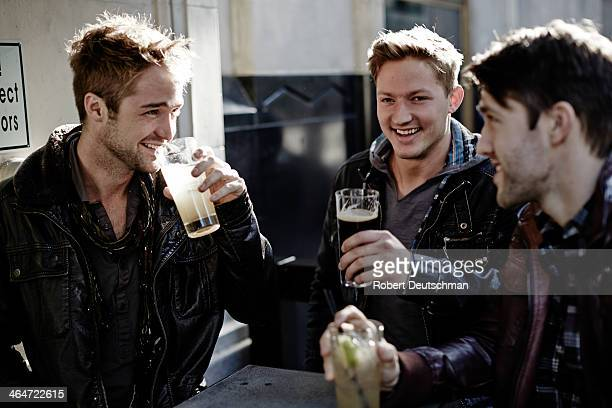 Male friends hanging out and having some drinks.