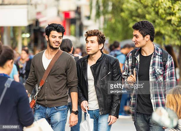 Male friends on city street