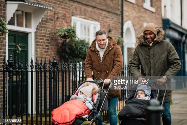 male friends out with their babies in tynemouth, uk - father stock pictures, royalty-free photos & images