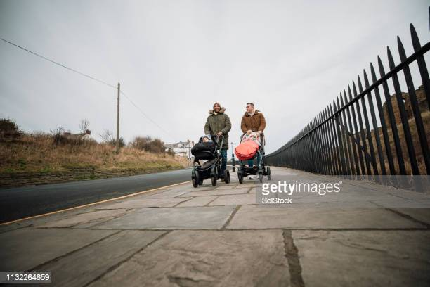 male friends out with their sons in tynemouth, uk - paternity leave stock pictures, royalty-free photos & images
