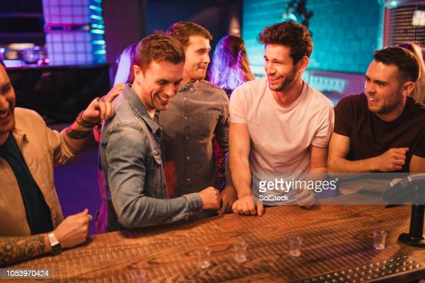 Male Friends Pulling Funny Faces after Taking a Shot