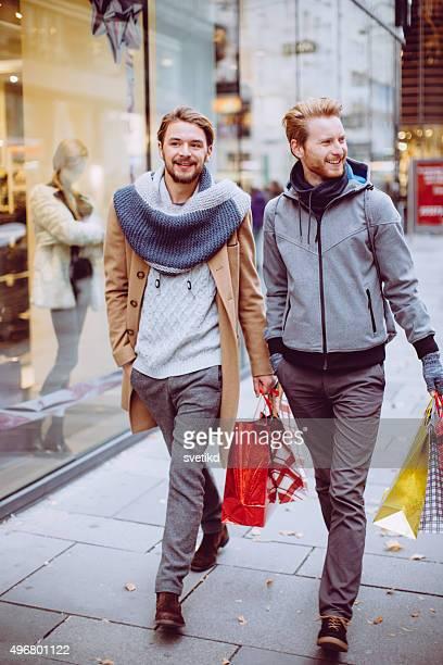 Male friends walking the street.