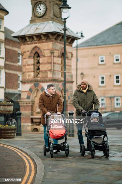male friends walking with their sons in tynemouth - paternity leave stock pictures, royalty-free photos & images