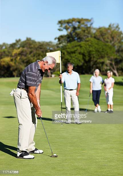 Male golf player putting