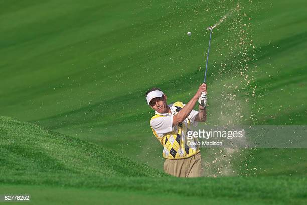 male golfer hitting ball out of bunker. - bunker stock pictures, royalty-free photos & images