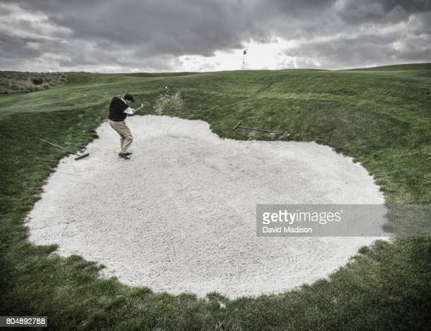 male golfer hitting out of sand trap - bunker stock pictures, royalty-free photos & images