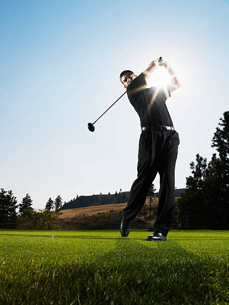 Male golfer hitting tee shot