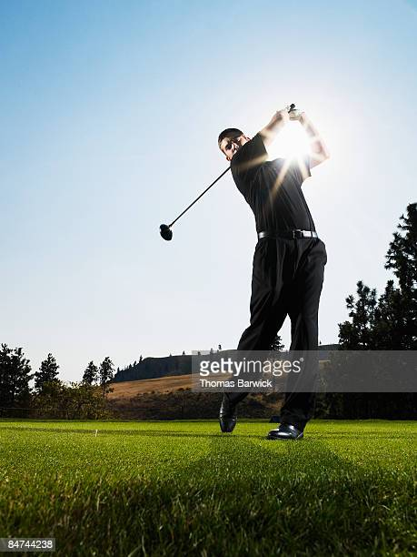 Male golfer hitting tee shot