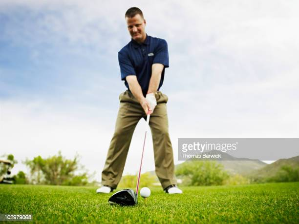 male golfer preparing to hit tee shot - teeing off stock pictures, royalty-free photos & images