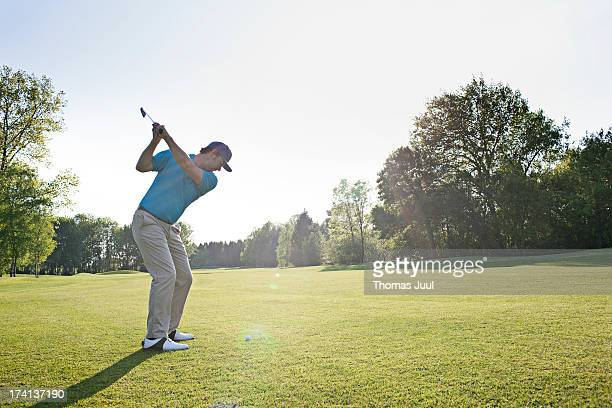 male golfer shooting with driver