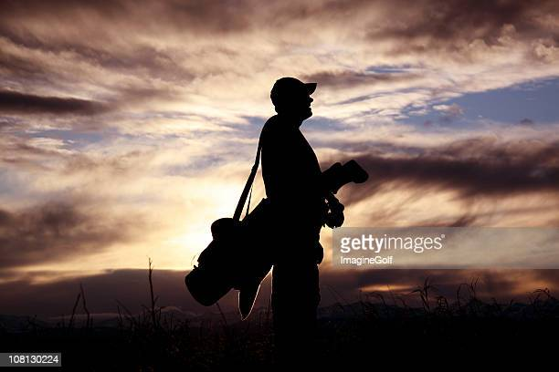 Male Golfer Silhouette Carrying Golf Bag