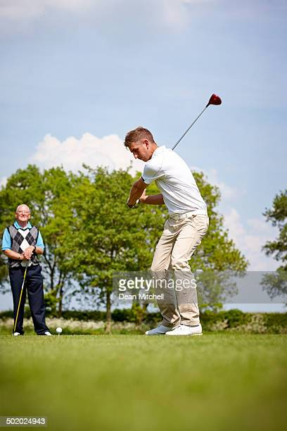 male golfer teeing off - driving range stock photos and pictures