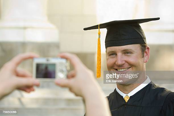 Male graduate having photograph taken