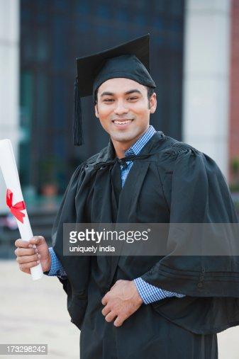 university student jumping his graduation diploma stock photo  keywords