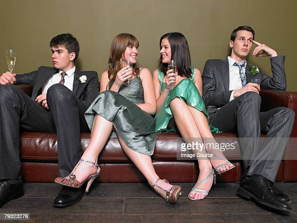 Male guests looking bored as female guests chat