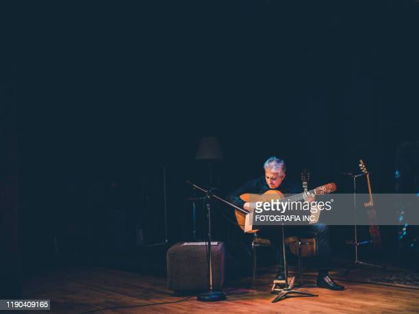 male guitarist performing on the stage - hamiltonmusical stock pictures, royalty-free photos & images
