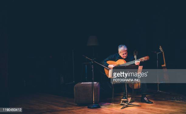 male guitarist performing on the stage - hamilton musical stock pictures, royalty-free photos & images