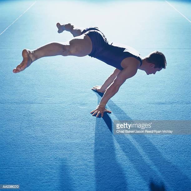 Male Gymnast Balancing During Floor Routine