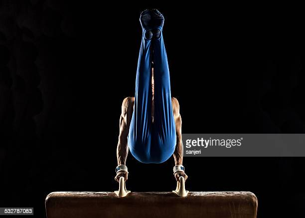 male gymnast doing handstand on pommel horse - artistic gymnastics stock pictures, royalty-free photos & images