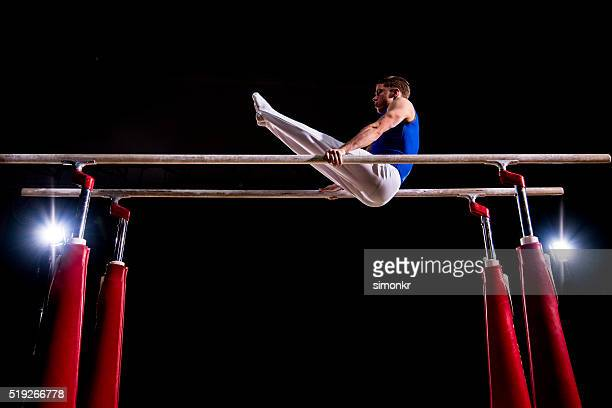 Male gymnast in sports hall