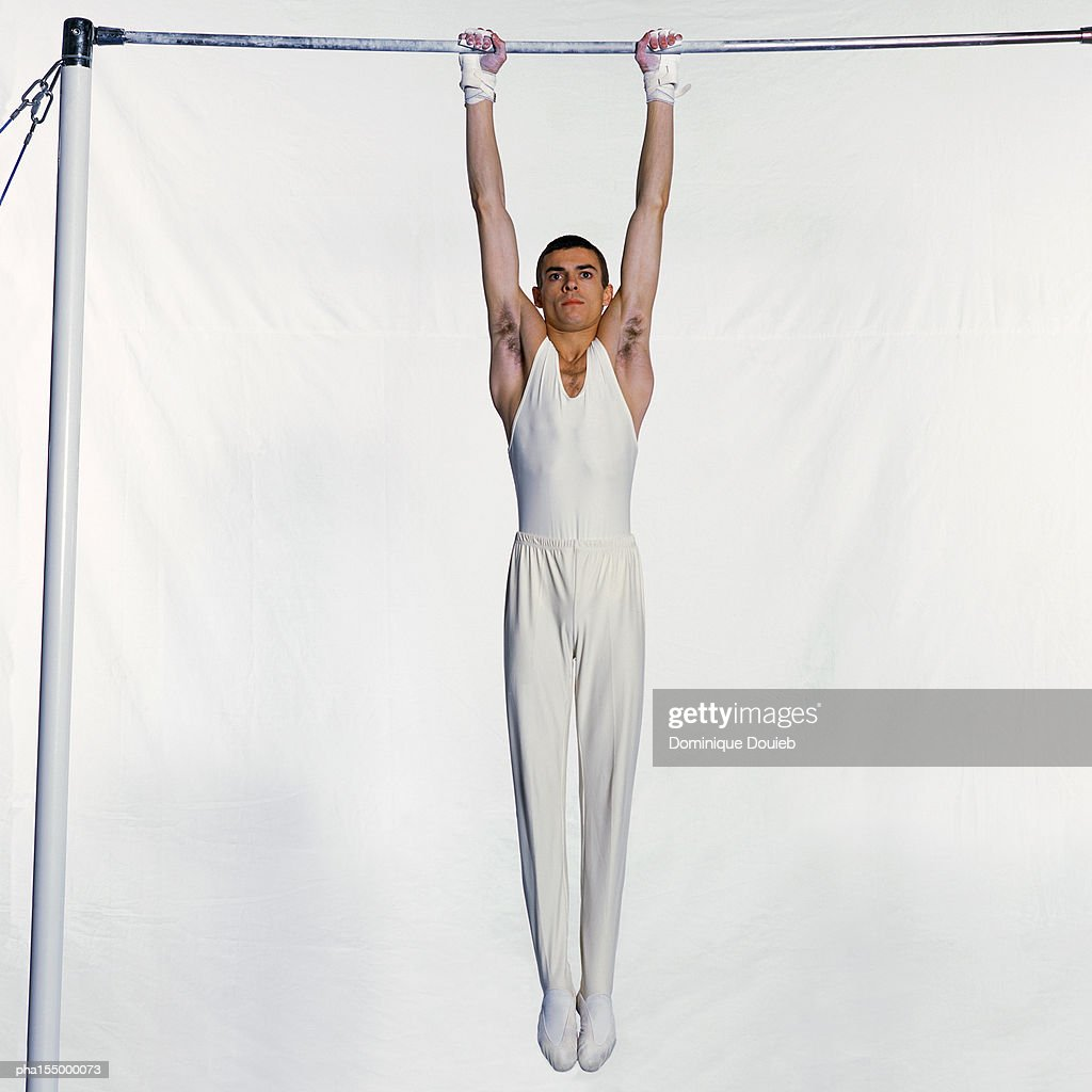 Male gymnast on horizontal bar. : Stockfoto