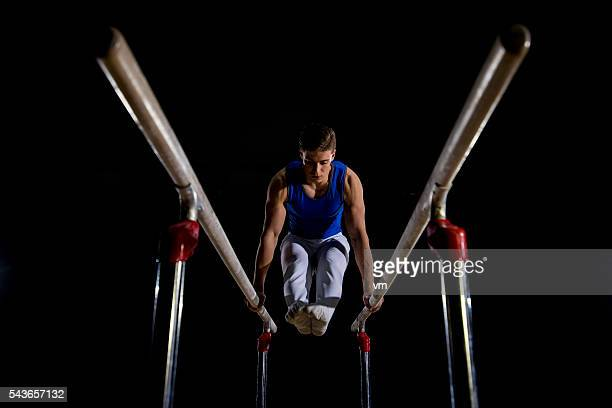 Male gymnast on parallel bars