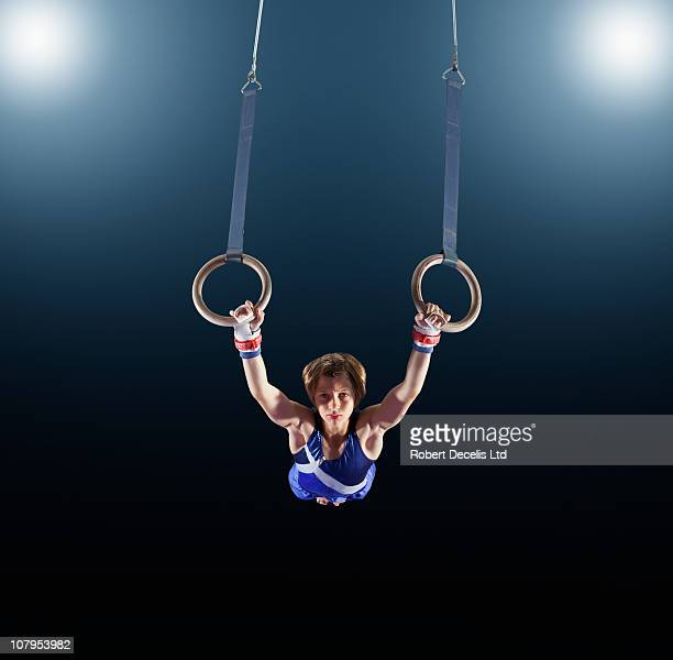 male gymnast performing on rings - sportsperson stock pictures, royalty-free photos & images
