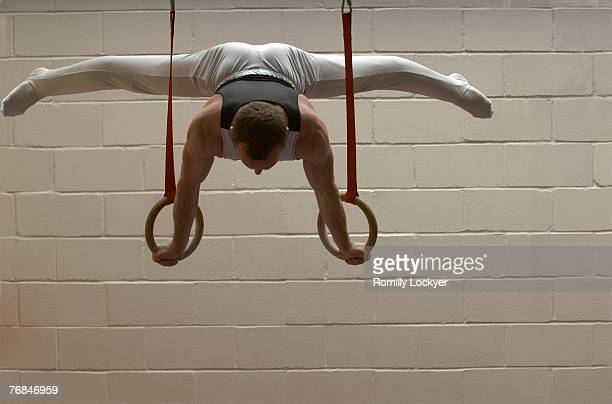 Male gymnast performing on rings