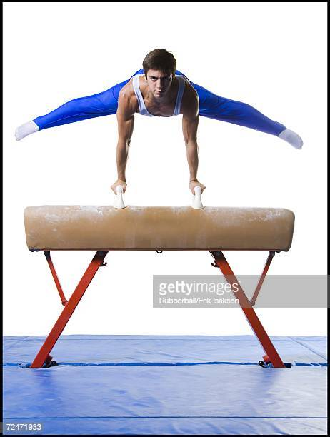 Male gymnast performing on vaulting horse