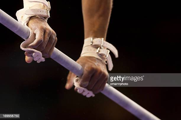 Male Gymnast's hands on high bar