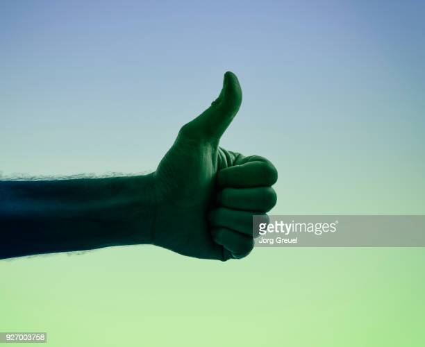 Male hand giving thumbs up