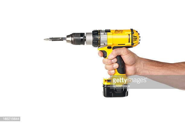 male hand holding a powere drill - drill stock pictures, royalty-free photos & images