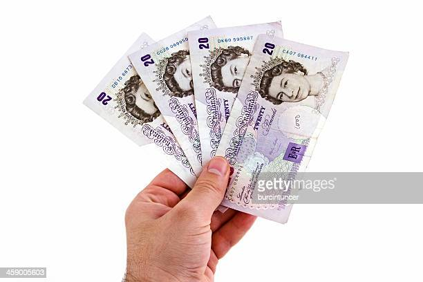 male hand holding british pound banknotes, isolated on white - twenty pound note stock photos and pictures