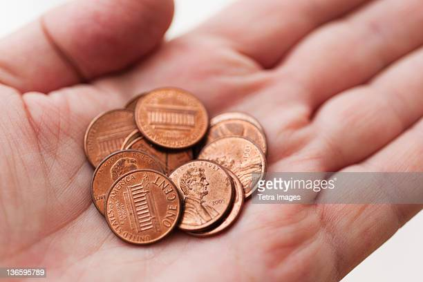 male hand holding coins - us penny stock pictures, royalty-free photos & images