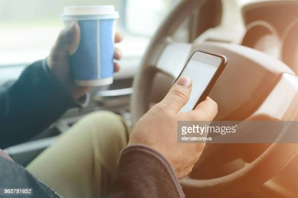 Male hand holding mobile phone