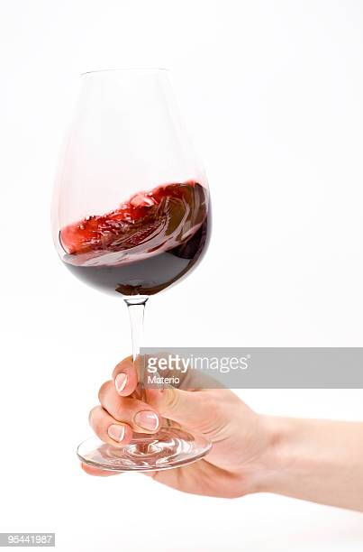 Male hand holding wine glass with red wine