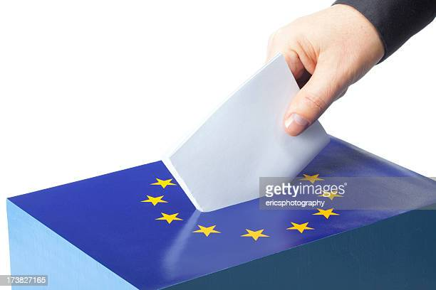 male hand inserting ballot to eu ballot box - europese etniciteit stockfoto's en -beelden