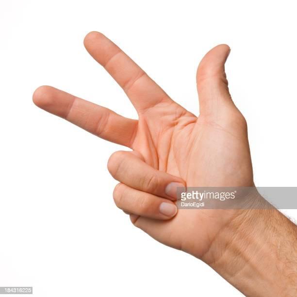 Mâle main faisant le numéro 3 sur fond blanc
