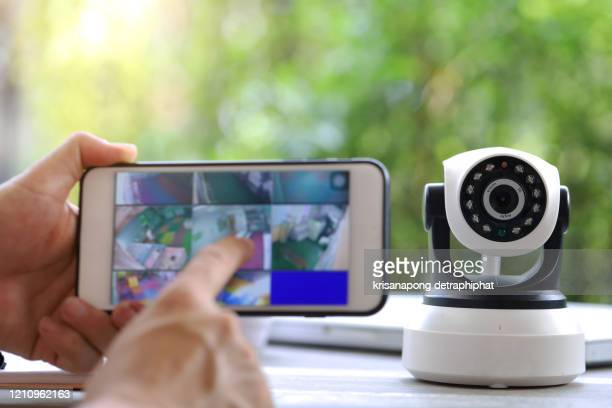 male hand press phone watch cctv - business security camera stock pictures, royalty-free photos & images
