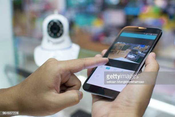 male hand press phone watch cctv - コントロール ストックフォトと画像