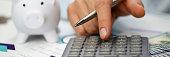 Male hand push key silver calculator is lying
