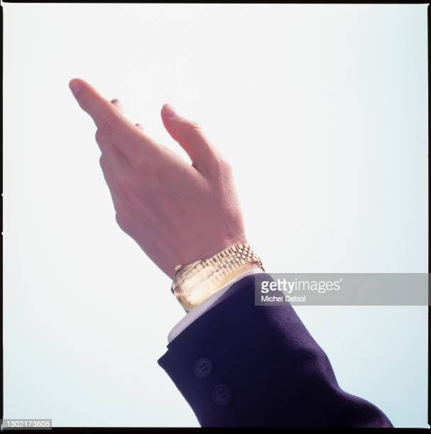 Male hand with gold watch in motion pointing upwards. Originally photographed for Fortune magazine. New York, New York, November 14th, 1995. Photo by...