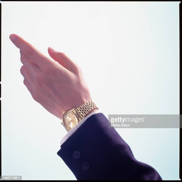 Male hand with gold watch pointing upwards. Originally photographed for Fortune magazine. New York, New York, November 14th, 1995. Photo by Michel...