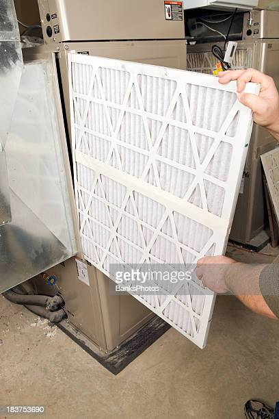 Male Hands Change Large Pleated Furnace Air Filter