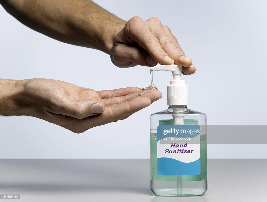 Male Hands Dispensing Hand Sanitizer : Stock Photo