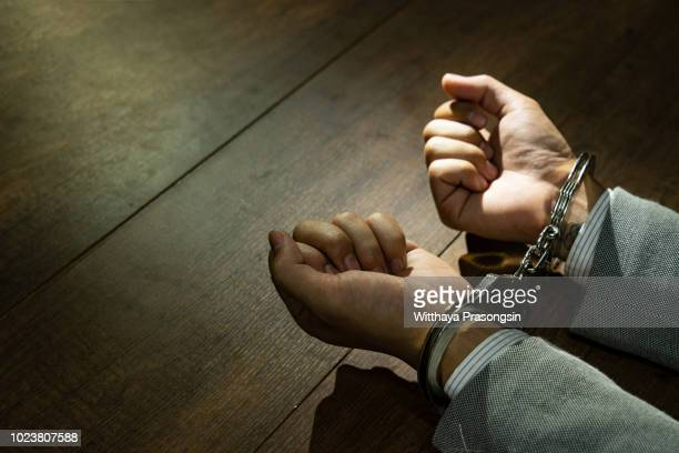 male hands in handcuffs - criminal stock pictures, royalty-free photos & images