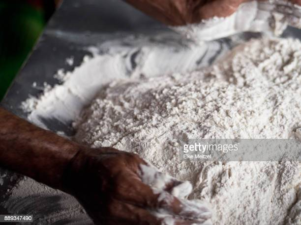 male hands mixing flour and water