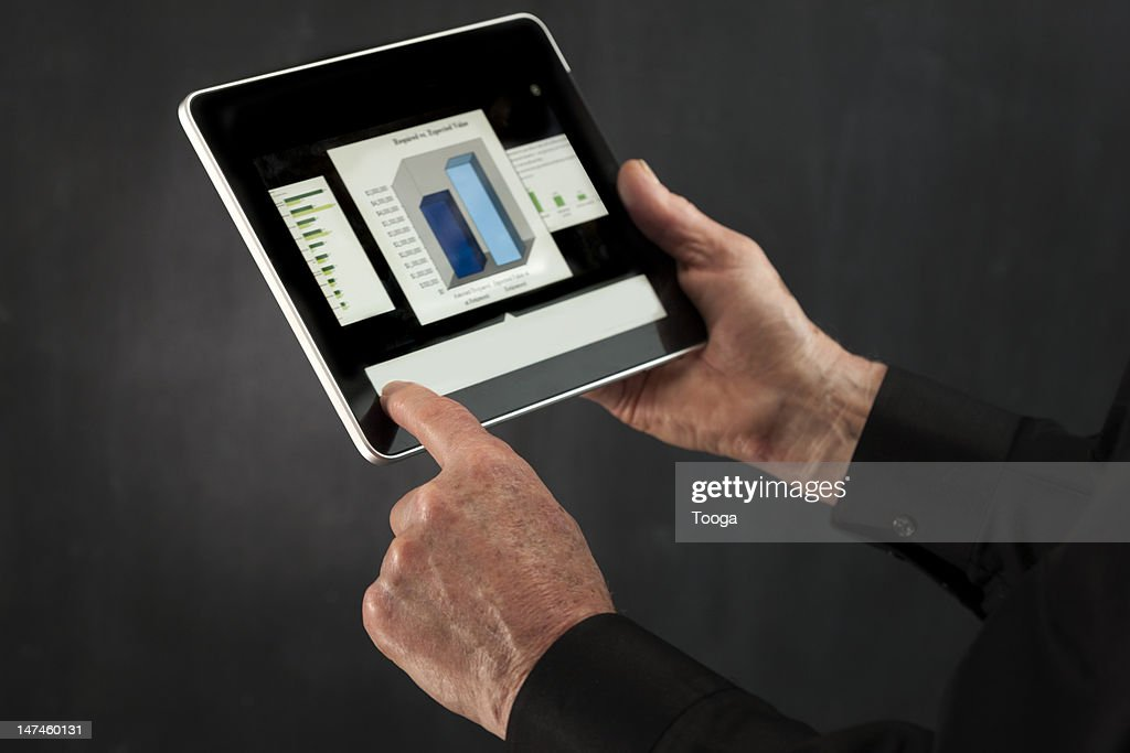Male hands using digital tablet : Stock Photo