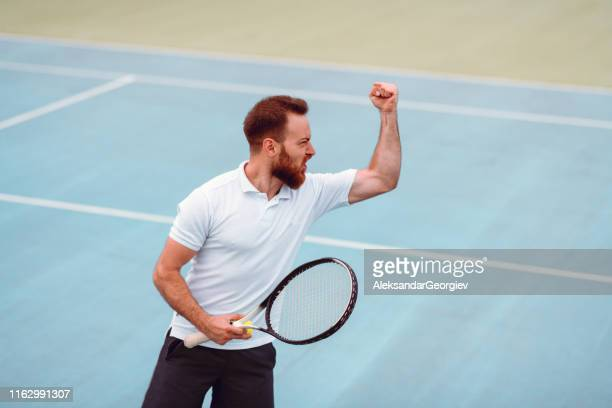 male happy about scored points during tennis match - tennis player stock pictures, royalty-free photos & images