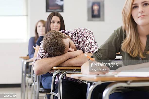 Male high school student asleep in class